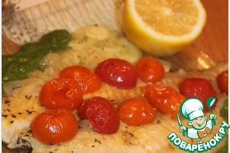 Филе тилапии с томатами черри, луком и соусом из рукколы