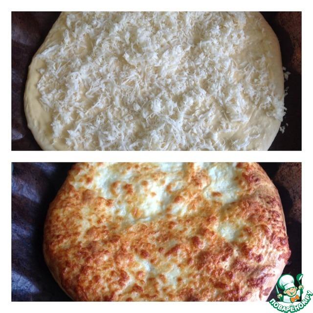 Сверху посыпаем сыром (50 гр) и ставим хачапури в духовку при 190*С - до зарумянивания.