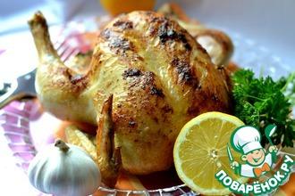 Курица, фаршированная чесноком и лимоном