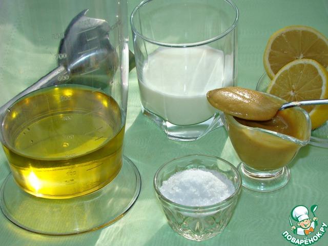 Пока запекается картофель, приготовим майонез. Для этого в высокий стакан влить оливковое масло, добавить горчицу, молоко, лимонный сок и щепотку соли.