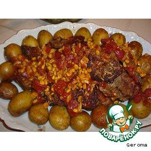 Мясо в духовке с кукурузой и томатами