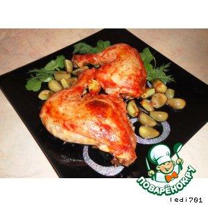 Куриные окорочка под томатным соусом с запеченными дольками чеснока