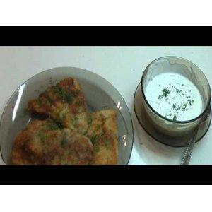 Филе пангасиуса в сухарях с белым соусом