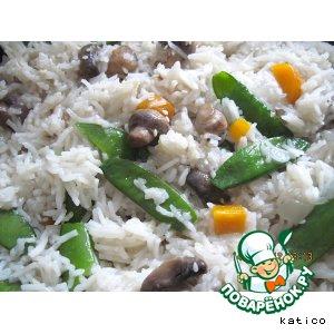 Рис с молодым зеленым горошком и грибами