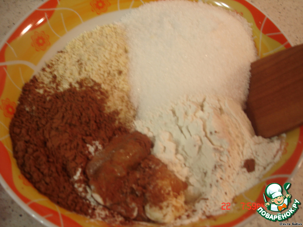 Смешать орехи, какао, сахар, ванилин, мед, растопленное масло, муку, хорошо перемешать деревянной ложкой.