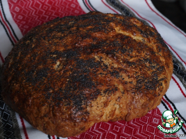 Духовку нагреть до 210-220 градусов и выпекать 35 минут.    Рецепт на этом в книге закончен, поэтому дальше - отсебятина: я духовку выключила и хлеб не доставала минут 15, потом вытащила и накрыла салфеткой, чтоб отдохнул.    Хлеб получился очень ароматный, с хрустящей корочкой!