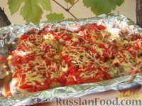 Рыба, запеченная с помидорами