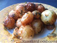 Молодой картофель, жаренный с чесноком и укропом