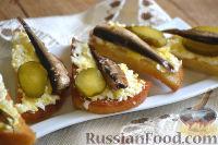 Бутерброды со шпротами, яйцом и огурцами
