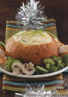 Морепродукты, запеченные с сыром в хлебе
