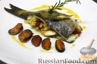 Морской волк фаршированный овощами с мидиями и шафрановым маслом