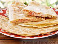 Лаваш с начинкой из колбасы,  помидора и сыра