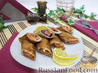 Роллы из блинчиков с красной рыбой и сыром